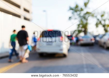 People And Car In Parking Area