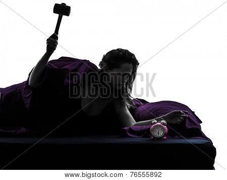 one woman in bed waking up smashing alarm clock silhouette studio on white background