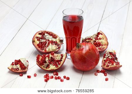 fresh pomegranate fruits and  juice