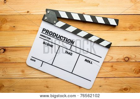 Movie slate film on wooden table