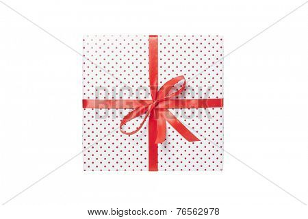 Gift with a ribbon and bow isolated on white background