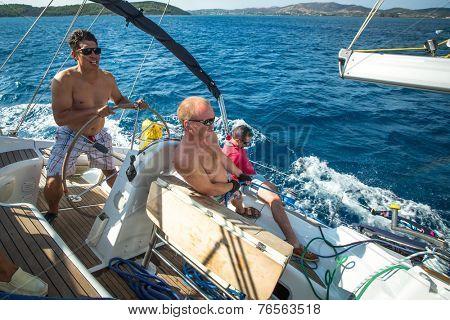 ERMIONI - POROS, GREECE - OCT 9, 2014: Unidentified sailors participate in sailing regatta