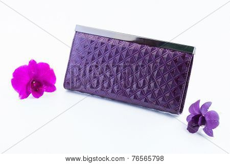 Woman Purple Purse (wallet) And Orchid Isolated On The White Background.