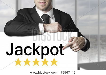 Businessman Pointing On Sign Jackpot Golden Stars