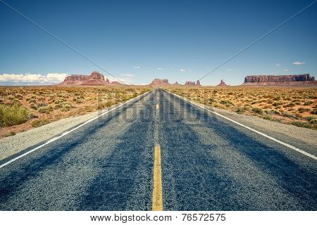 Desert Highway Leading Into Monument Valley