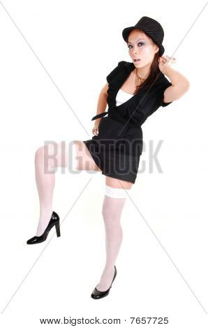 Woman Standing On One Leg.