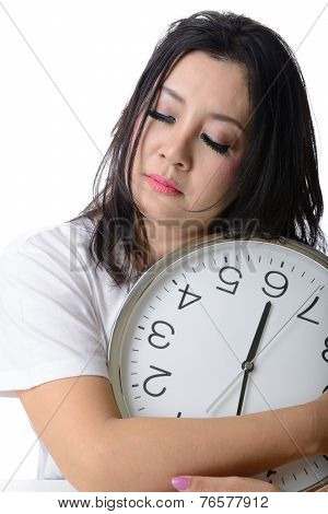 Sleepy Asian Woman Hug The Clock.