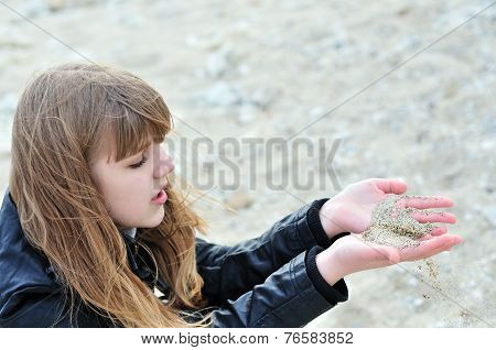 Sand Slips Through  Fingers