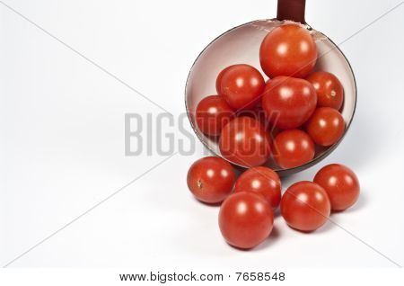 Tomatos and a ladle