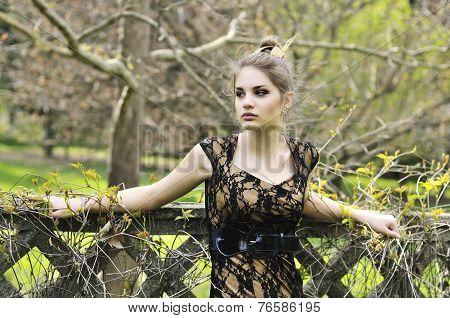 Elegant Girl Near The Wall