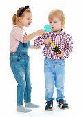 stock photo of montessori school  - Girl and boy looking in the mirror - JPG
