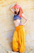 stock photo of turban  - Woman wearing a turban in the desert - JPG