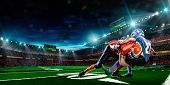 picture of arena  - American football player in action in the stadium - JPG