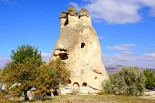 stock photo of chimney rock  - Picturesque landscape with Fairy chimneys Cappadocia in Turkey. ** Note: Visible grain at 100%, best at smaller sizes - JPG