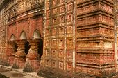 stock photo of radha  - Terracotta decorated walls of Pancharatna Govinda Temple in Puthia - JPG