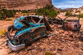 picture of wrecking  - Abandoned Car wreck with bullet holes Utah canyon - JPG