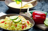 picture of tabouleh  - Couscous with grilled chicken meat and vegetables fresh lime on top - JPG