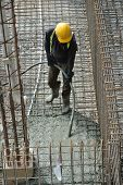 pic of vibrator  - A construction worker using a concrete vibrator at a construction site in Selangor - JPG