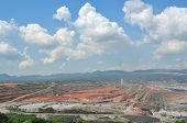 stock photo of open-pit mine  - open pit mining of coal and working machinery - JPG