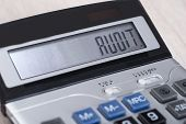 foto of financial audit  - Closeup of calculator with Audit on display  - JPG