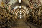 stock photo of underworld  - Dark and long undergorund passage with light - JPG