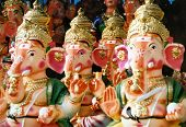 stock photo of ganesh  - 3 Ganesh statues in line ready to be sold for the Ganesh Birthday Festival in Bangalore - JPG