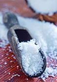 image of grating  - grated coconut  in spoon and on a table - JPG