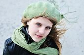 picture of beret  - young teenage girl wearing beret standing outdoors in windy day - JPG