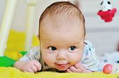 stock photo of tongue  - a lovely baby with her tongue out - JPG