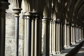stock photo of quadrangles  - Sunlight catching the side of quadrangle walkway at Salisbury cathedral - JPG