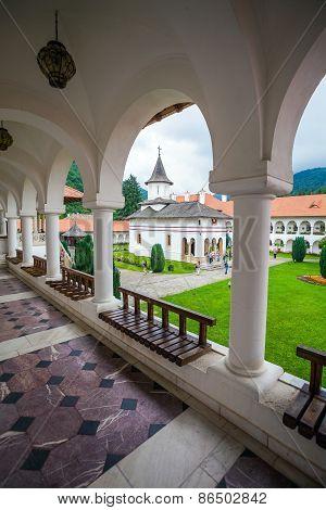 Church Inside Sambata De Sus Monastery Seen Trough A Colonade In Transylvania