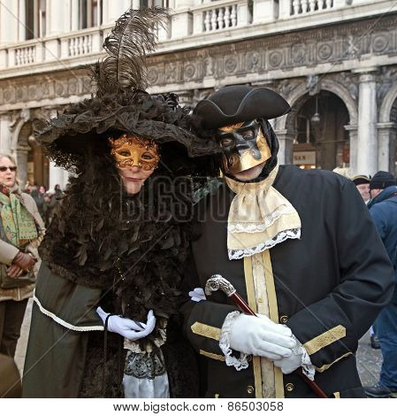 Masked Persons On San Marco Square During Carnival In Venice, Italy.