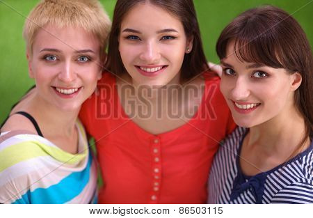 Portrait of three young women, standing together