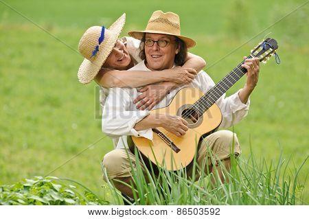 Playing Guitar And Hugging