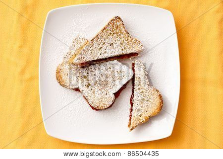 Toast Bread With Strawberry Jam Filling On Plate