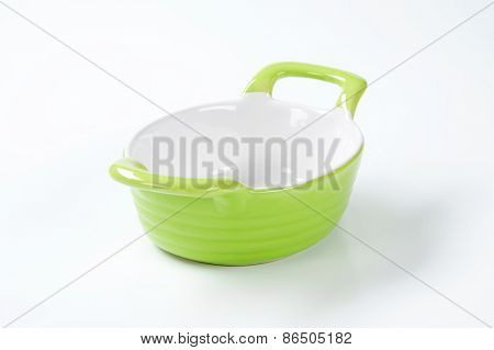 green casserole dish on white background