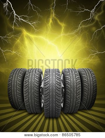 Wedge of new car wheels. Yellow background with lightning and stripes at bottom