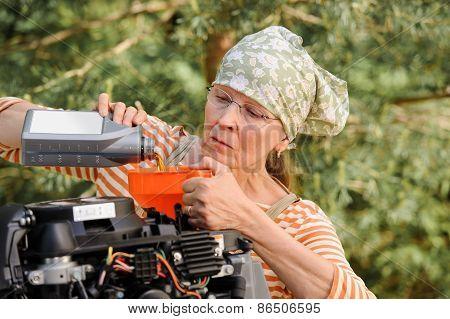 Senior Woman Changing Oil