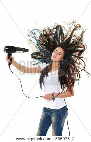 Female drying her hair with hair-drier