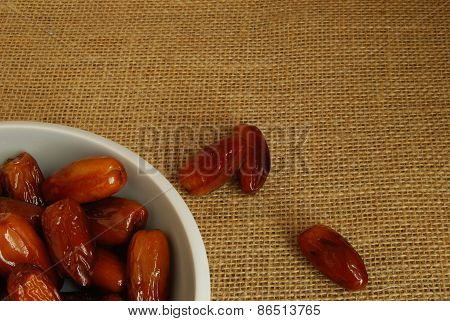 Dates in a Bowl on Hessian