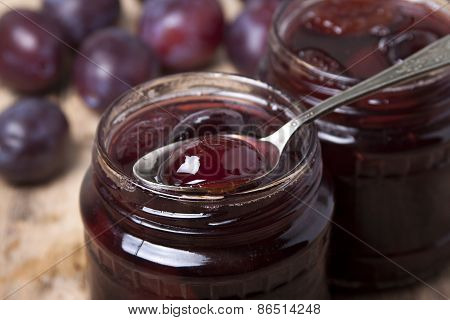 Plum Jam In A Glass Jar  .