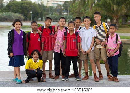 LAEM CHABANG, THAILAND, DECEMBER 26: A group of unidentified casual Thai kids is posing in the park of the Laem Chabang city in Thailand.