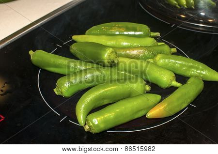 Green chilies on hot plate