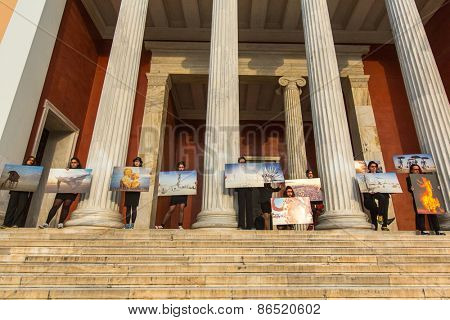 ATHENS, GREECE - MAR 28, 2015: Unidentified participants actions of contemporary art - Burning Man Walking Photo Exposition on territory National Archaeological Museum of Athens.