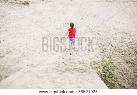 Boy running barefoot at the beach