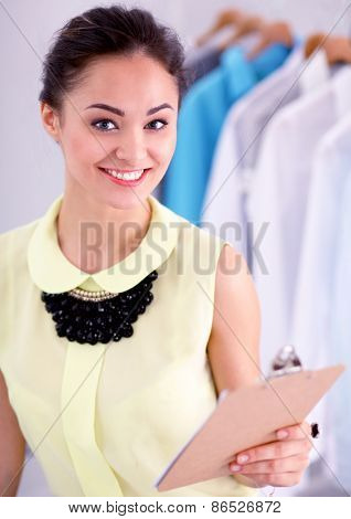 Modern young fashion designer working at studio.isolated