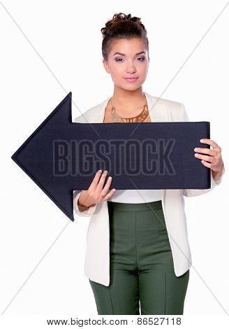 Beautiful young business woman holding a black arrows, over a white