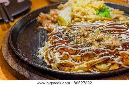 Closeup Cooking Okonomiyaki Or Japan Pizza With Hot Iron Frying Pan