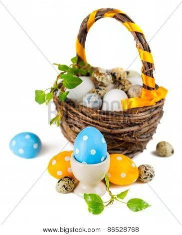 Easter eggs in basket on a white background