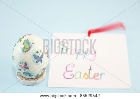 Hand Painted Easter Egg On Blue Background